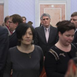 Members of Jehovah's Witnesses react in a court room after judge's decision in Moscow, Russia, on Thursday, April 20, 2017.  Russia's Supreme Court has banned the Jehovah's Witnesses from operating in the country, accepting a request from the justice ministry that the religious organisation be considered an extremist group, ordering closure of the group's Russia headquarters and its 395 local chapters, as well as the seizure of its property. (AP Photo/Ivan Sekretarev)