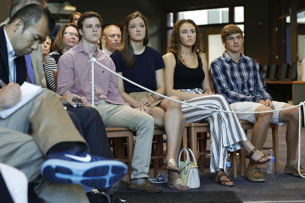 Friends and relatives gather to listen as Fred Warmbier, father of Otto Warmbier, a University of Virginia undergraduate student who was imprisoned in North Korea in March 2016, as he speaks during a news conference, Thursday, June 15, 2017, at Wyoming Hi