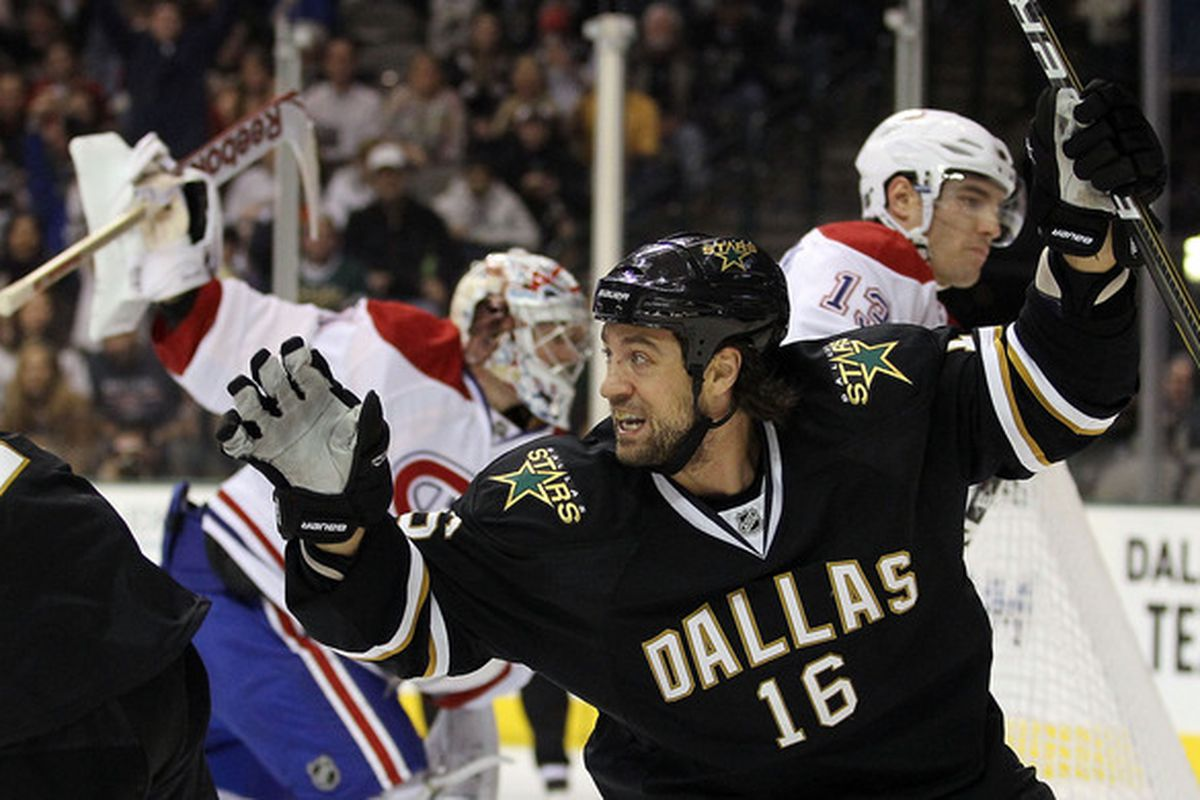 DALLAS TX - DECEMBER 21:  Right wing Adam Burish #16 of the Dallas Stars celebrates a short handed goal against the Montreal Canadiens at American Airlines Center on December 21 2010 in Dallas Texas.  (Photo by Ronald Martinez/Getty Images)