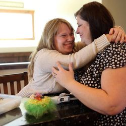 Annalise Simmons hugs her mother Amy Simmons at their home in Kamas on Saturday, Aug. 24, 2013. Annalise was adopted from Russia with three of her biological sisters.