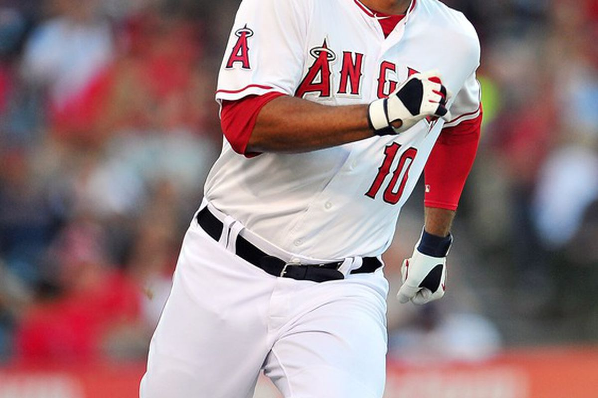 May 15, 2012; Anaheim, CA, USA; Los Angeles Angels left fielder Vernon Wells (10) runs to first after hitting a single in the sixth inning against the Oakland Athletics at Angel Stadium. Mandatory Credit: Gary A. Vasquez-US PRESSWIRE