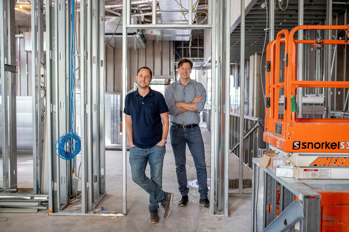 Partners Matt Adler and Michael Babin inside the space that will hold Caruso's Grocery.
