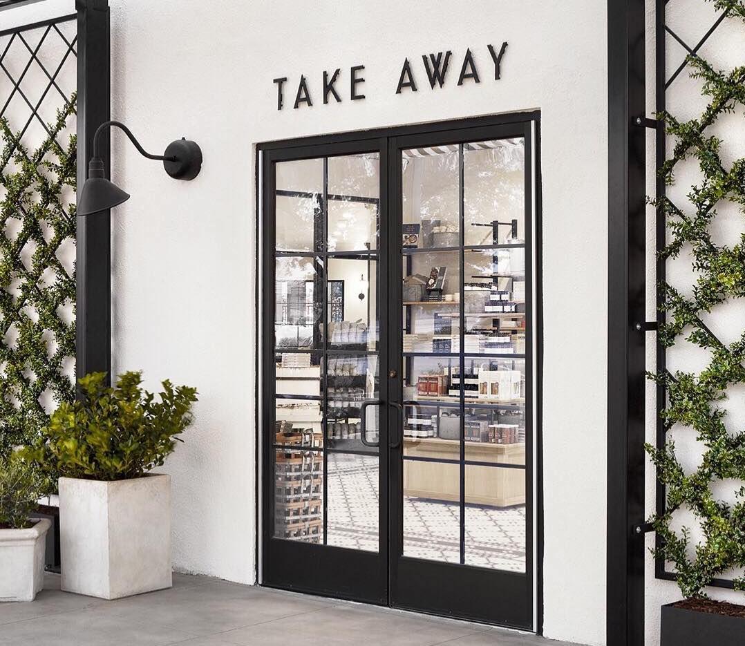 "Entrance sign reading ""Take Away"" at Magnolia Table"