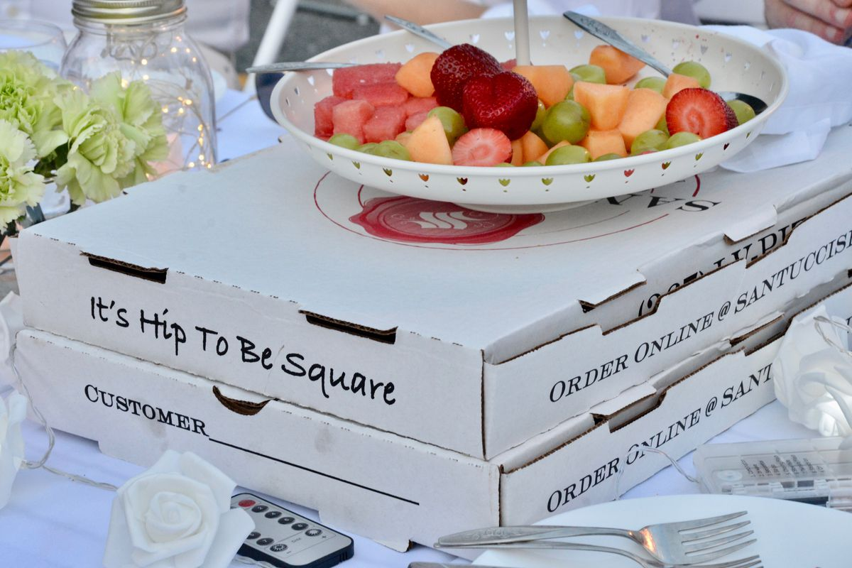 santucci's pizza boxes and a bowl of fruit