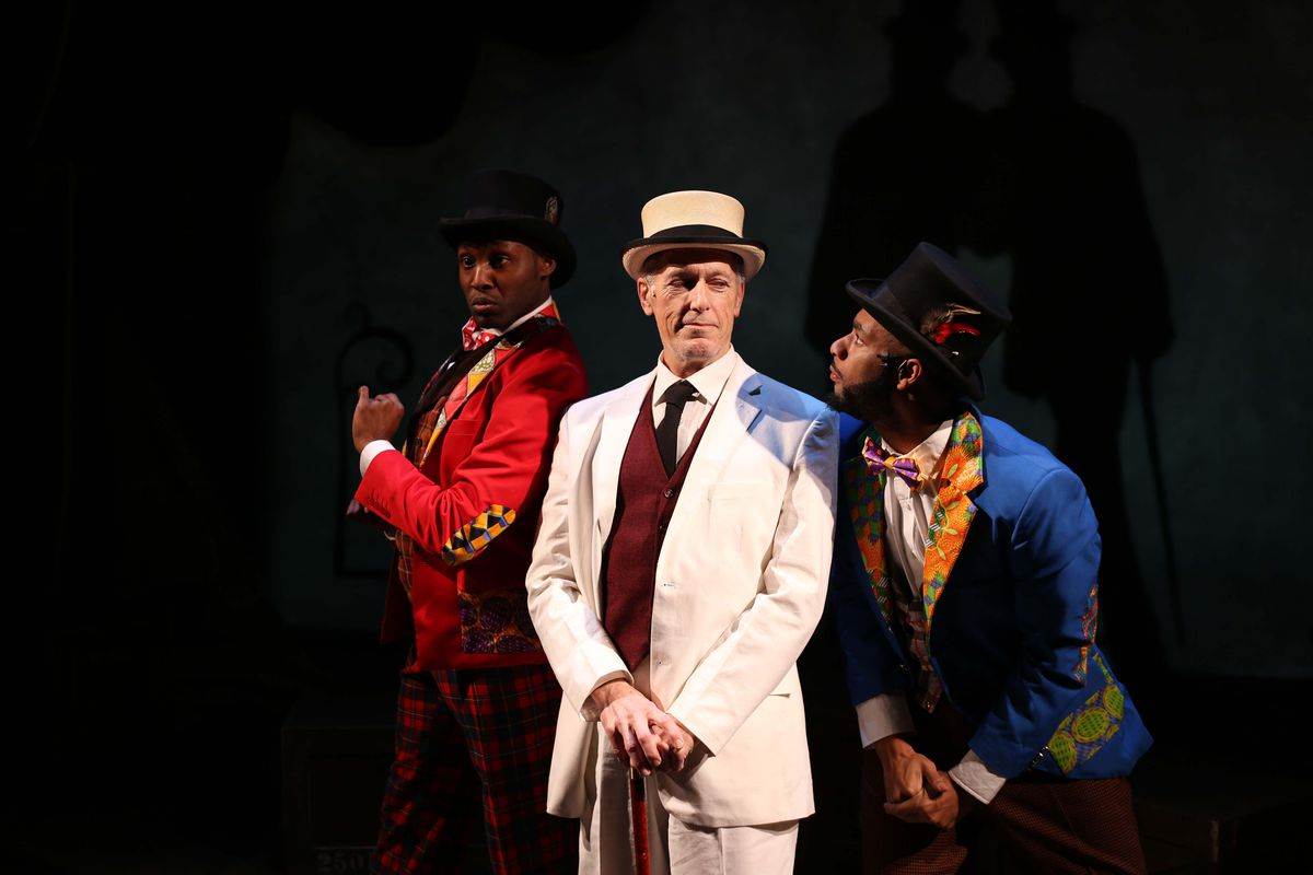 """Denzel Tsopnang (from left) as Mr. Bones, Larry Yando as The Interlocutor, and Mark J.P. Hood as Mr. Tambo in the Porchlight Music Theatre production of """"The Scottsboro Boys,"""" a Kander and Ebb musical. (Photo: Kelsey Jorissen)"""