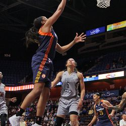 Connecticut Sun's Morgan Tuck (33) goes in for a layup.