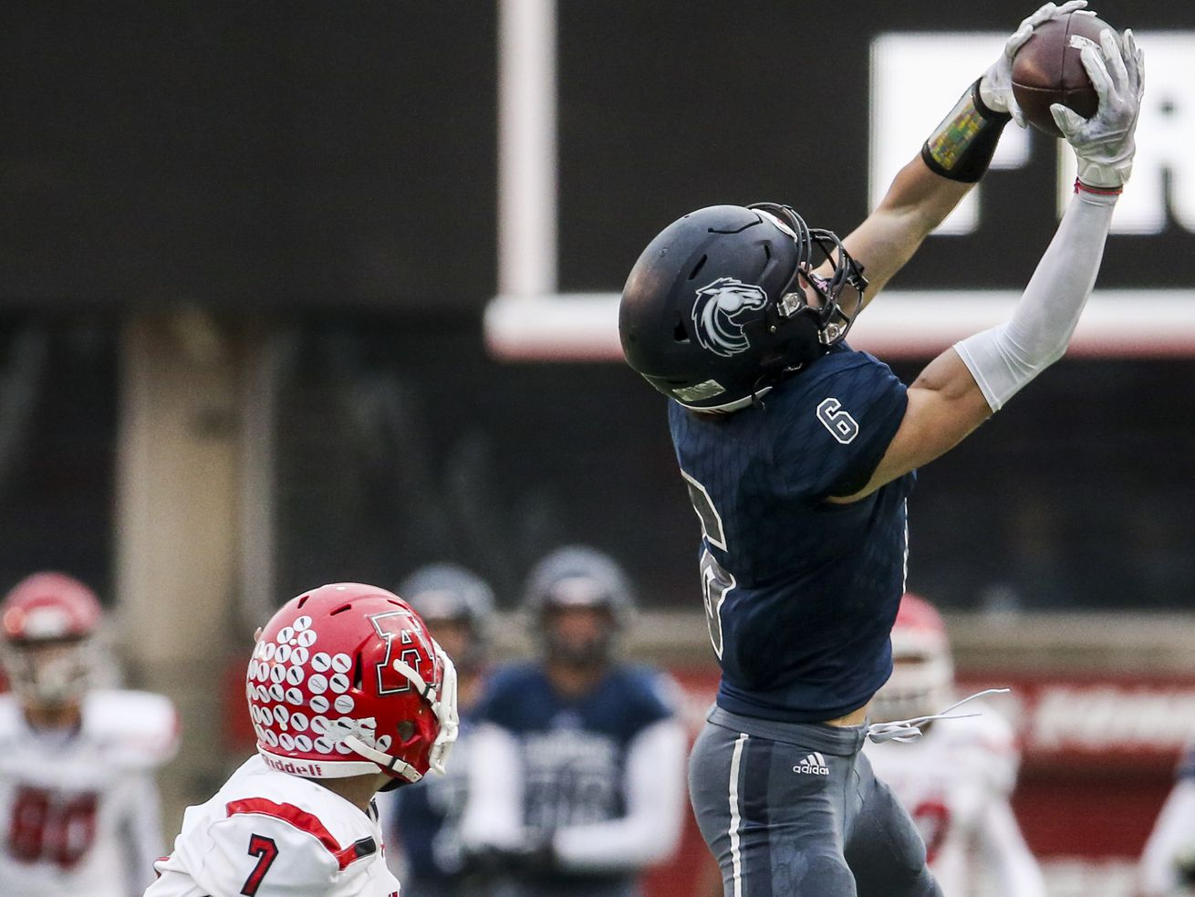 Corner Canyon wide receiver Talmage Handley (6) makes a catch over the head of American Fork safety Peyton Wilson (7) during the first half of the 6A state high school football game at Rice-Eccles Stadium in Salt Lake City on Friday, Nov. 22, 2019.