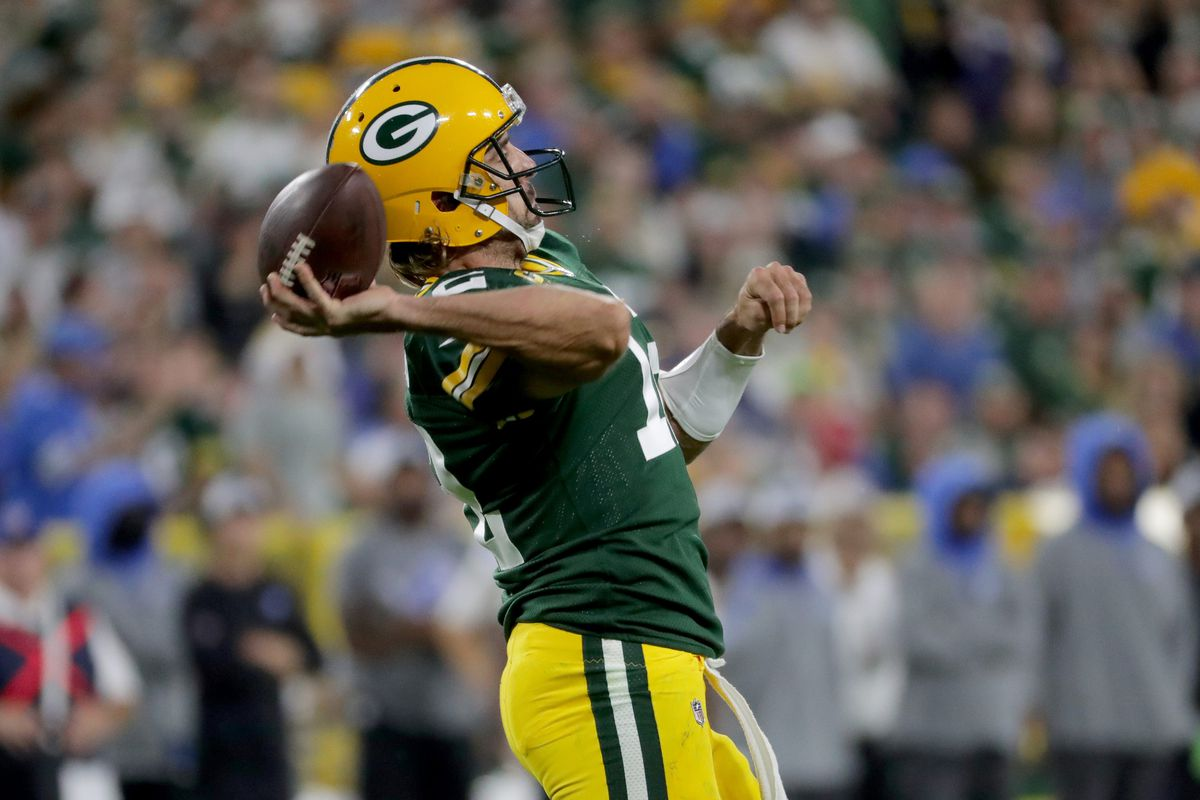Green Bay Packers quarterback Aaron Rodgers (12) makes a 50-yard completion to Green Bay Packers wide receiver Davante Adams during the third quarter of their game Monday, September 20, 2021 at Lambeau Field in Green Bay, Wis. The Green Bay Packers beat the Detroit Lions 35-17.