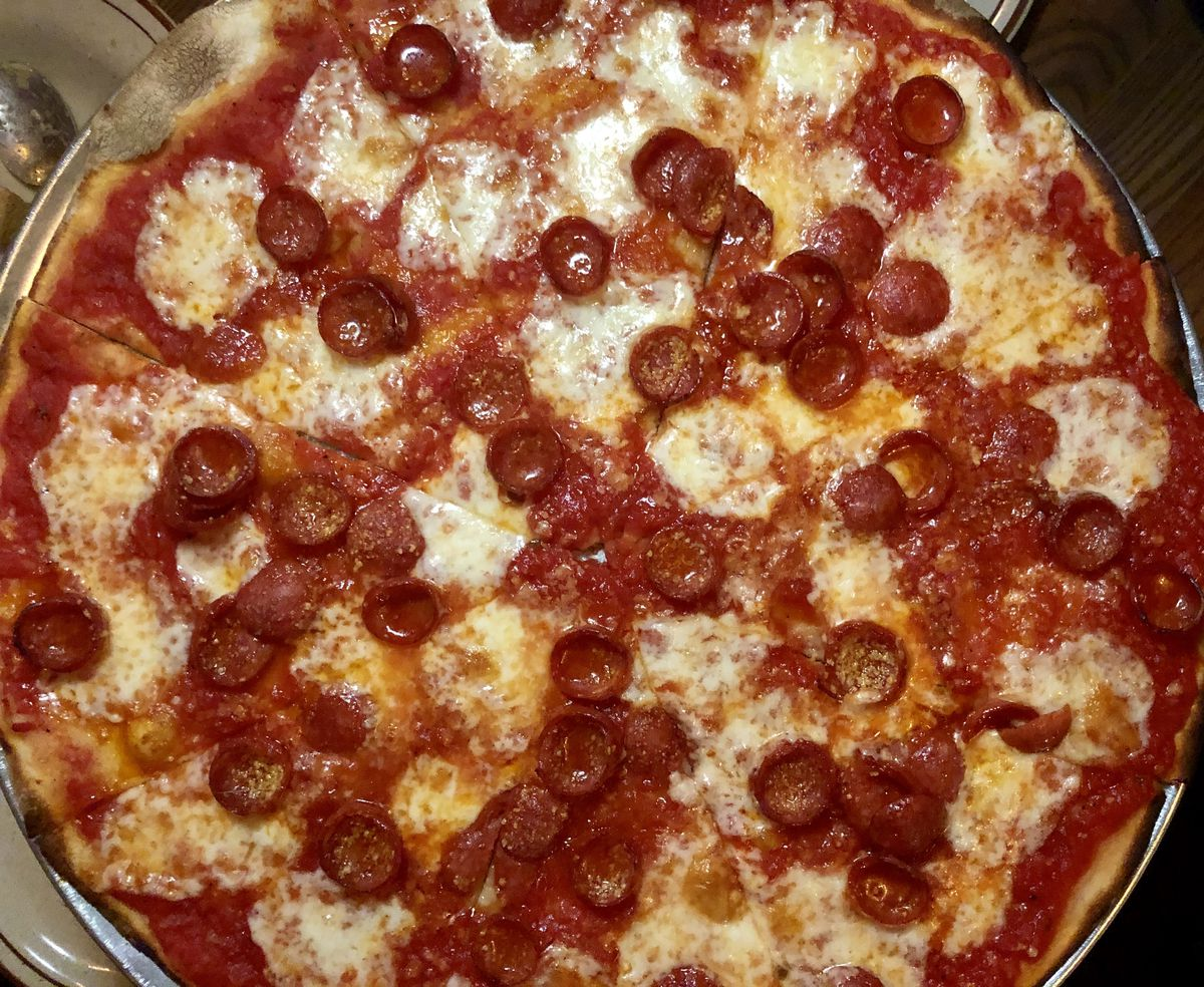 A tomato pizza topped with pepperoni at Joe & Pat's