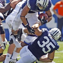 Brigham Young Cougars running back Michael Alisa (42) flies over defenders during the first half as Brigham Young University plays Weber State University in football  Saturday, Sept. 8, 2012, in Provo, Utah.