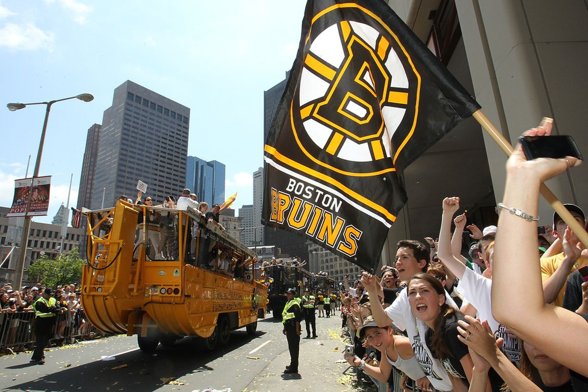 BOSTON, MA  - JUNE 18:  Fans of the Boston Bruins react during a Stanley Cup victory parade on June 18, 2011 in Boston, Massachusetts.  (Photo by Jim Rogash/Getty Images)