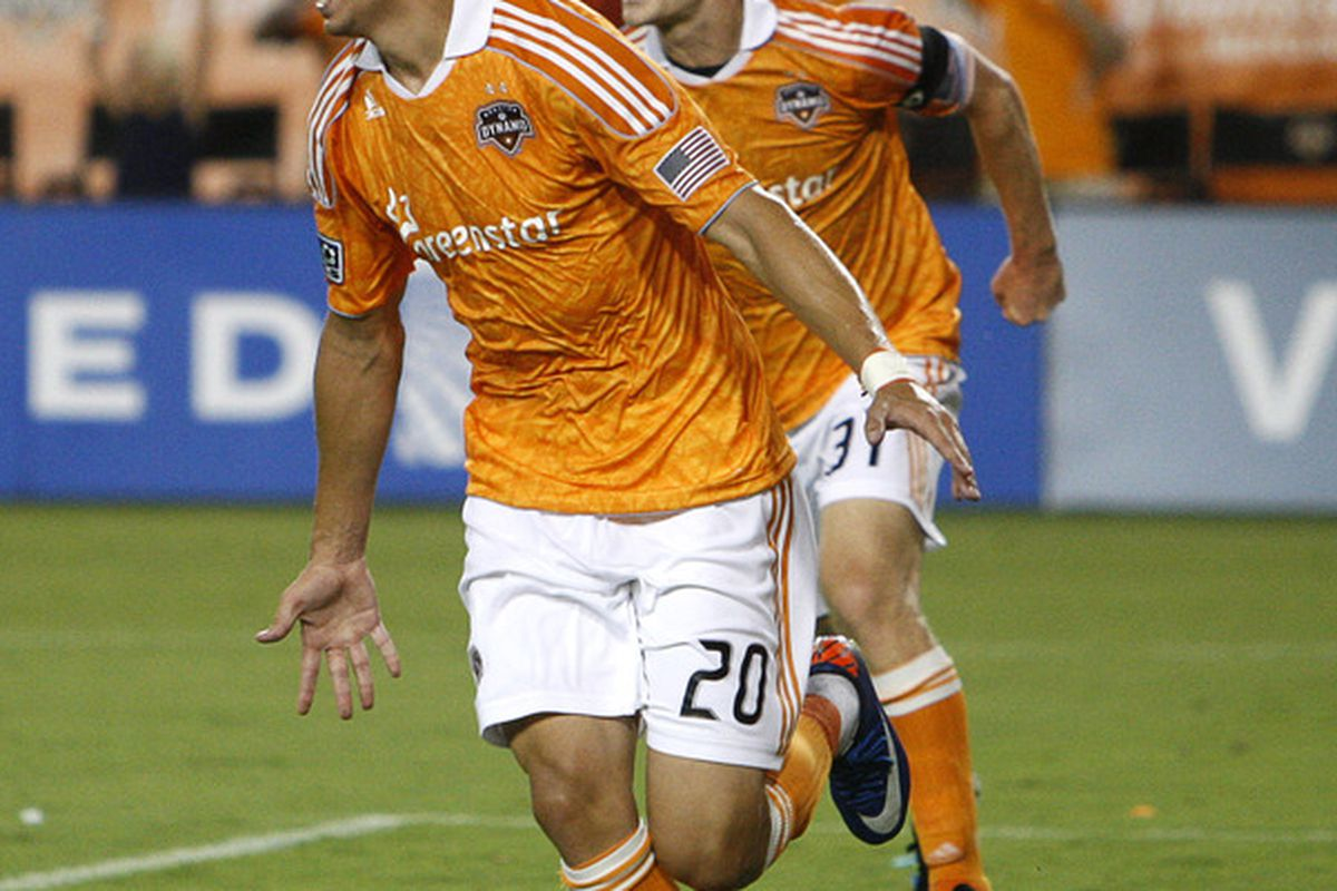 HOUSTON - JULY 09:  Geoff Cameron #20 and Andre Hainault #31 of the Houston Dynamo celebrate after Cameraon scored in the 81st minute against Toronto FC at Robertson Stadium on July 9, 2011 in Houston, Texas.  (Photo by Bob Levey/Getty Images)