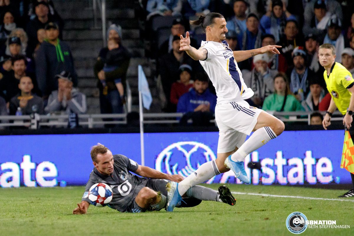 October 20, 2019 - Saint Paul, Minnesota, United States - Minnesota United defender Chase Gasper (77) slides in to win the ball from LA Galaxy forward Zlatan Ibrahimovic (9)during the Minnesota United vs LA Galaxy first round playoff match at Allianz Field.