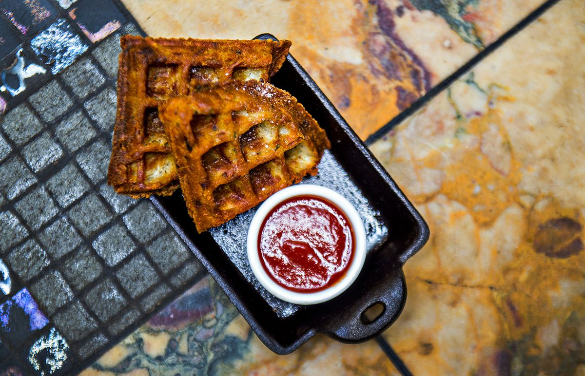 Crispy potato waffles served in cast iron at Ivy on 7th