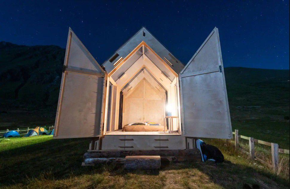 Cabin with doors opened wide.