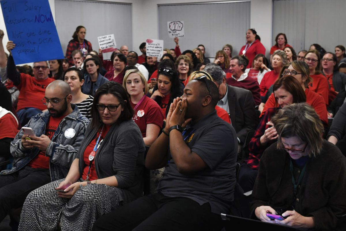 File photo shows Denver teachers packing a January bargaining session.