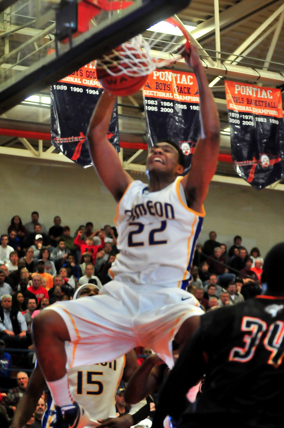 Jabari Parker executes a powerful dunk for Simeon against Peoria Manual.