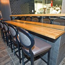 """Five seat """"chef's table"""" with a front row view of the kitchen."""