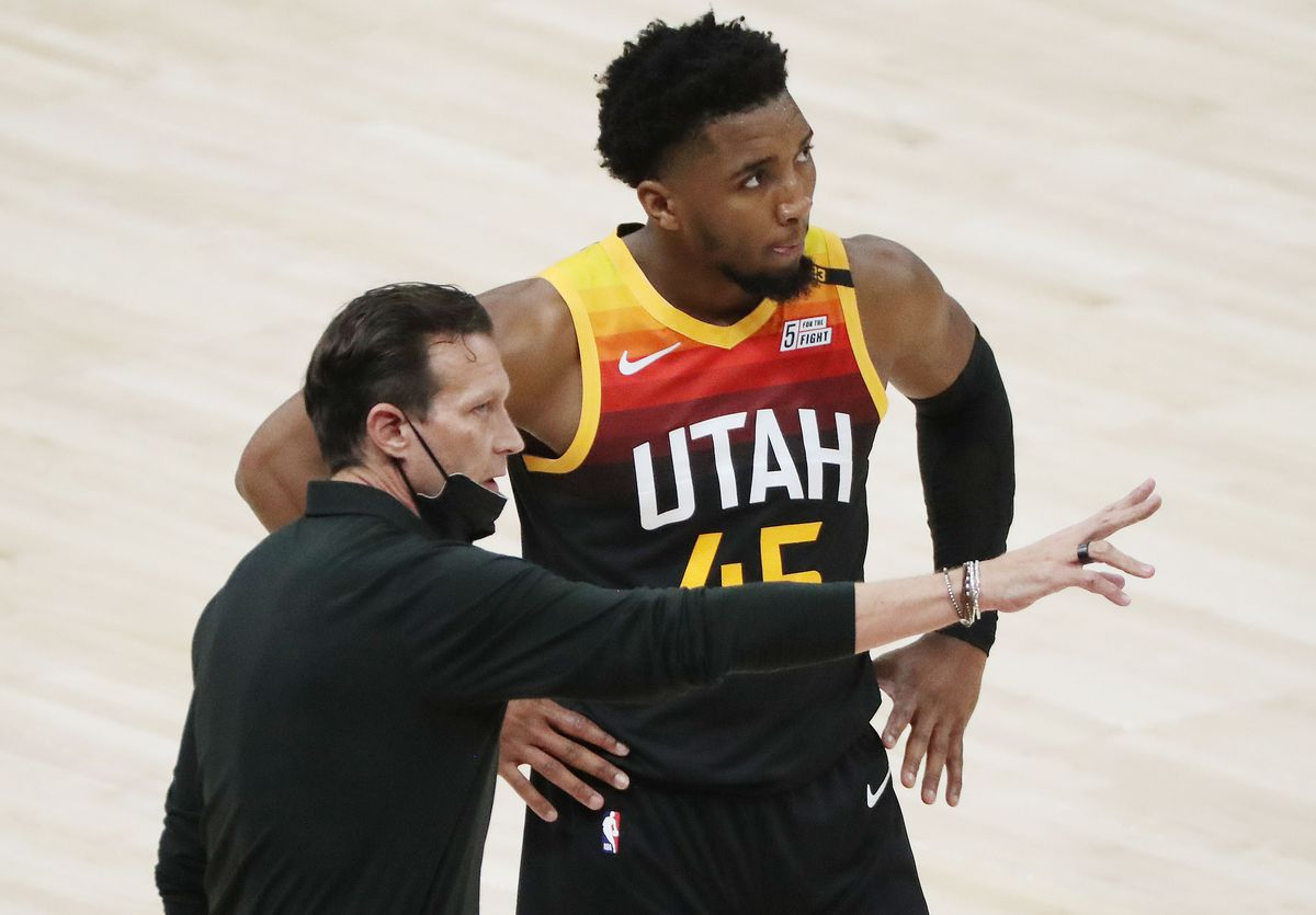 Utah Jazz coach Quin Snyder talks with Utah Jazz guard Donovan Mitchell (45) during a timeout in Salt Lake City on Friday, April 2, 2021. The Jazz won 113-106.