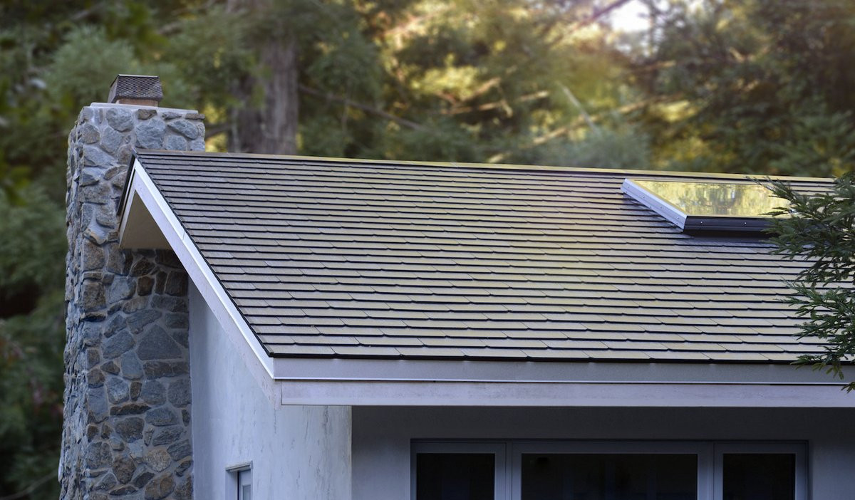 A close up of an early Tesla solar roof installed.