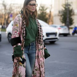 Italy meets Paris in this Gucci (robe) and Vetements (hoodie) combo.