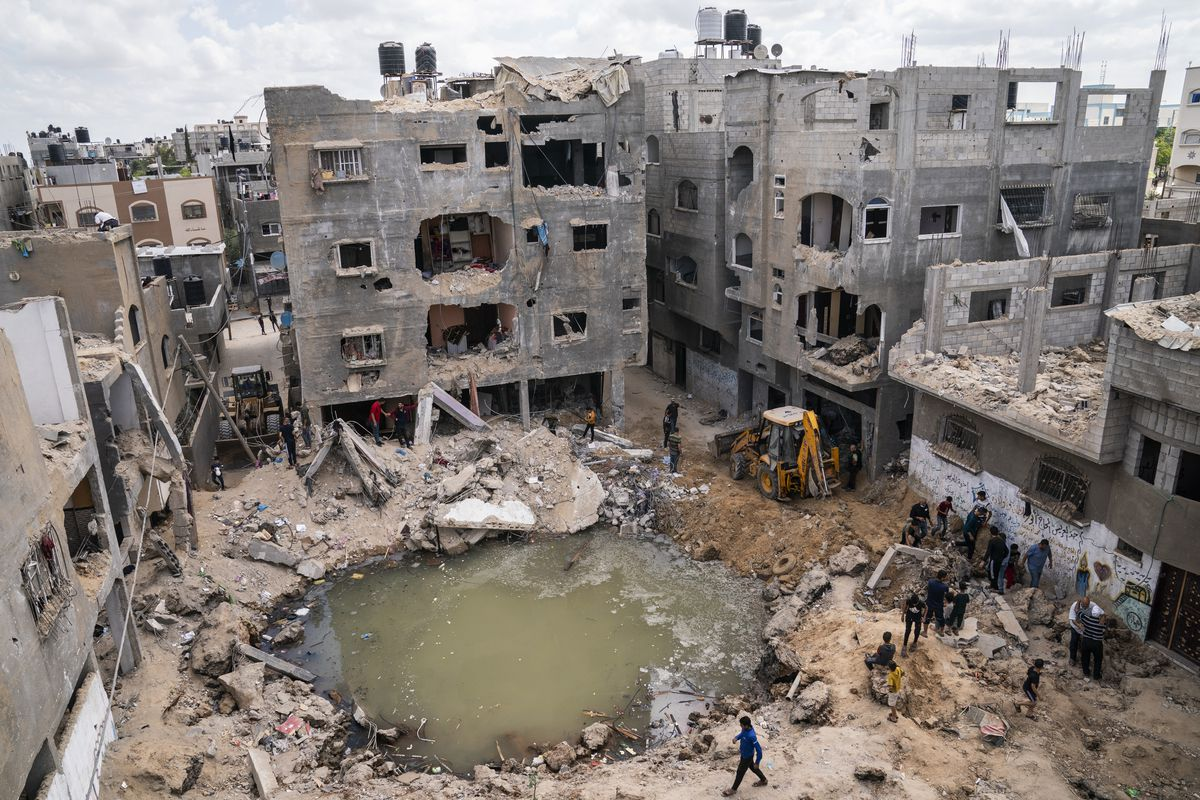 A crater full of water and sewage remains where the home of Ramez al-Masri was destroyed by an air-strike prior to a cease-fire reached after an 11-day war between Gaza's Hamas rulers and Israel, Sunday, May 23, 2021, in Beit Hanoun, the northern Gaza Strip.