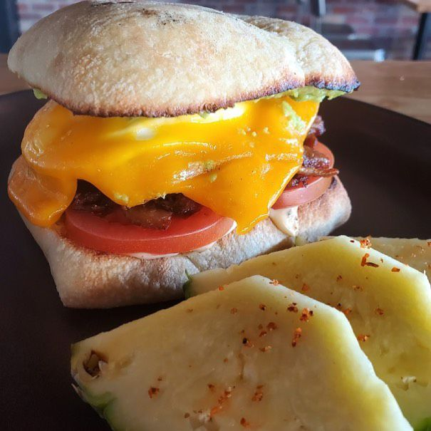 Breakfast sandwich with cheese and tomato