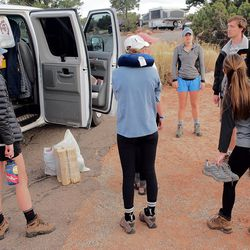 Students from the University of Virginia's Alternative Spring Break program consult on their next move after being kicked out of their campsite in Southern Utah because someone else had reserved the site. The program has been entirely run by students since its inception in 1992, with no oversight from faculty, administration or alumni.