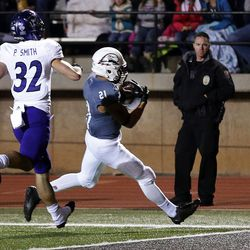 Southern Utah Thunderbirds running back Jay Green  runs for a touchdown with Weber State Wildcats safety Preston Smith following during NCAA football in Cedar City on Saturday, Dec. 2, 2017.