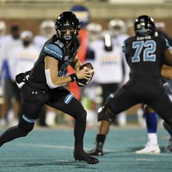 Coastal Carolina quarterback Grayson McCall, left, scrambles during the first half of an NCAA college football game against BYU, Saturday, Dec. 5, 2020, in Conway, S.C.