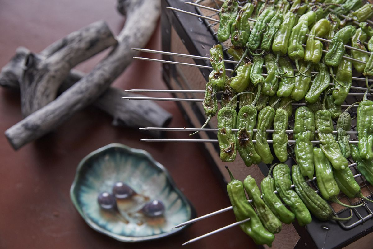Shishito peppers grilled over the binchotan