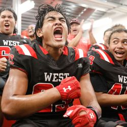 West's Shemiah Collins cheers with his teammates before a high school football game against Roy High on Friday, Sept. 10, 2021, at West High School in Salt Lake City.