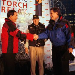 From left to right, Sandy Douglas (Coca-Cola),  Mac Whisner (Chevrolet)  Mitt Romney (SLOC) announced that Coca Cola and Chevrolet are now sponsors on Feb. 7, 2000.