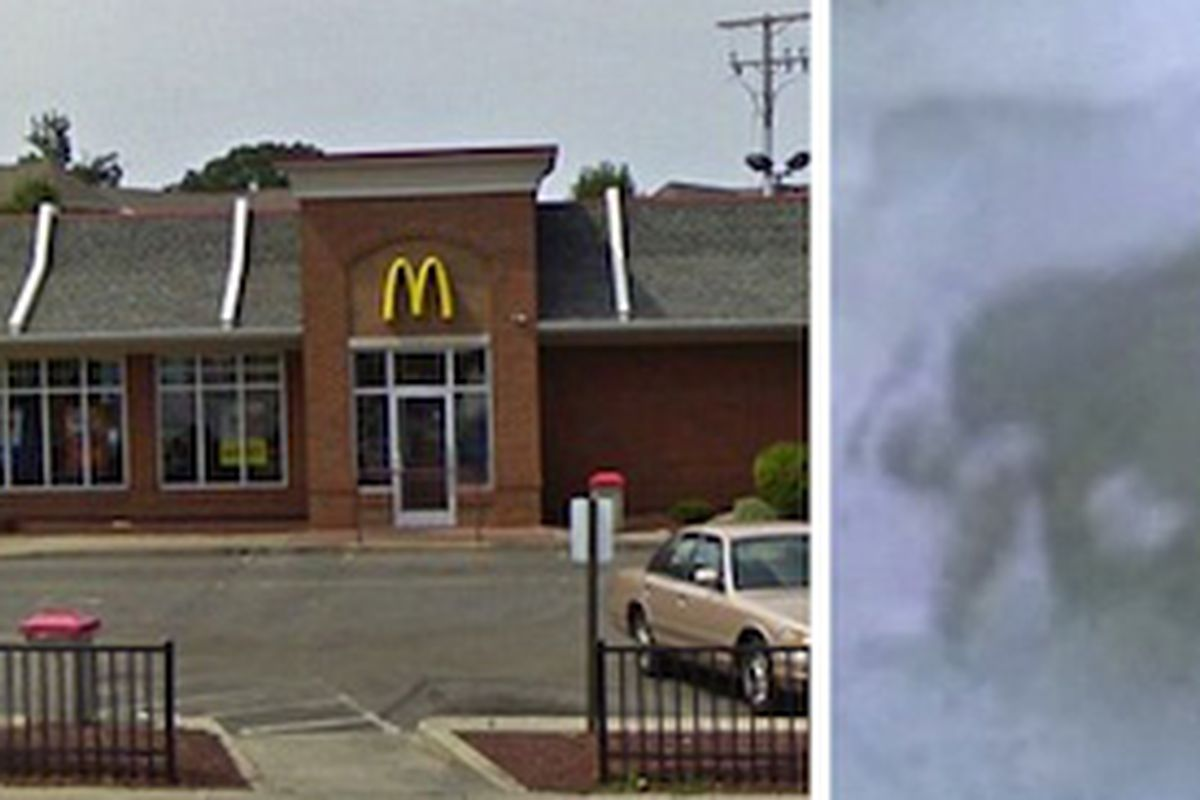 The McDonald's in question; the car backs into two bystanders.
