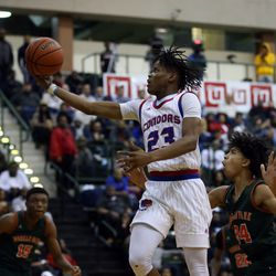 Curie's Ramean Hinton (23) scores ahead of Morgan Park's Deshawndre Washington (24) during their 65-60 CPS championship at Chicago State University in Chicago, Sunday, February 17, 2019. | Kevin Tanaka/For the Sun Times