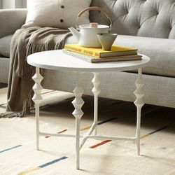 """<span class=""""credit""""><a href=""""http://www.westelm.com/products/steven-alan-side-table-round-h527/"""">Papier-Mâché Round Side Table</a>, $299</span><p>"""