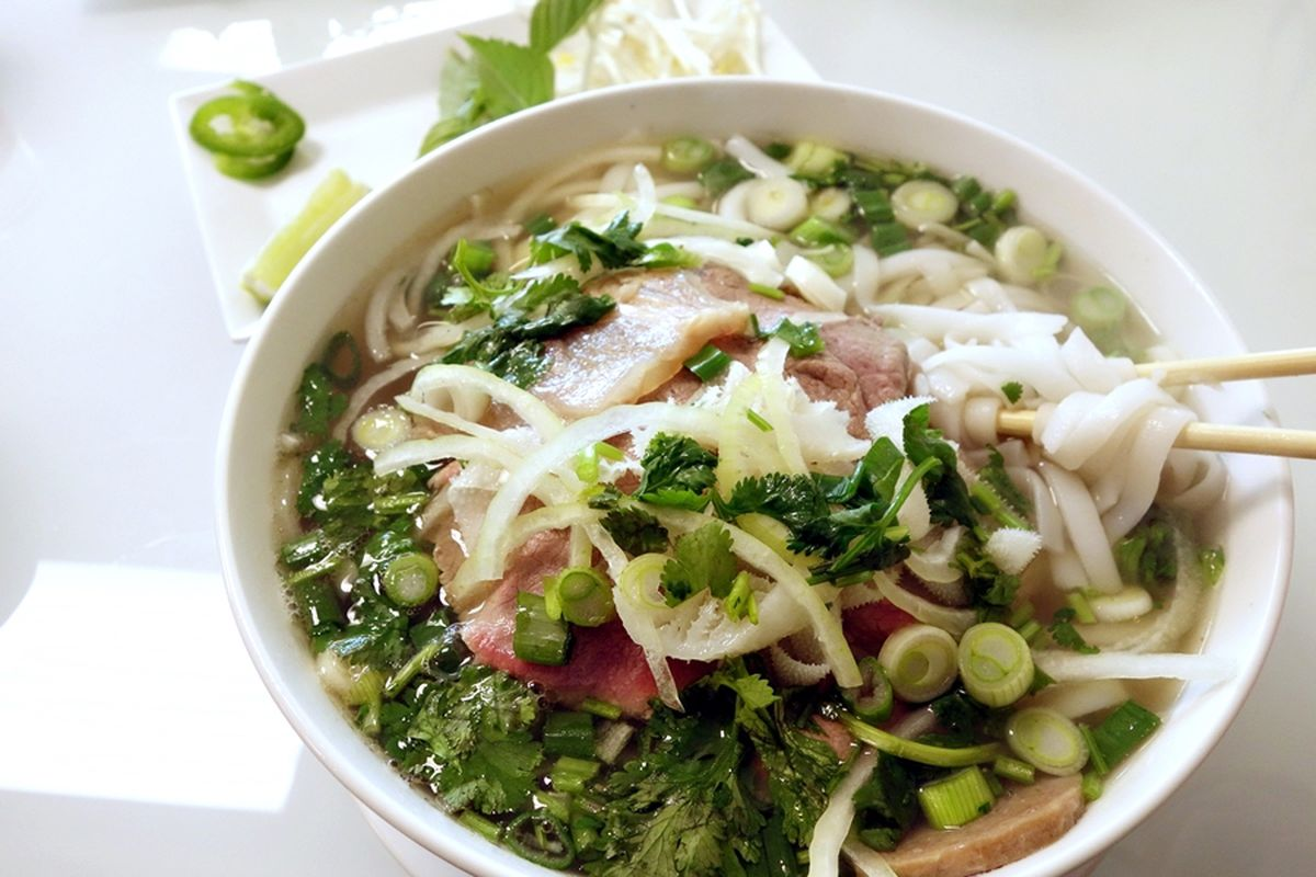 A bowl of pho with chopsticks from Dong Thap Noodles