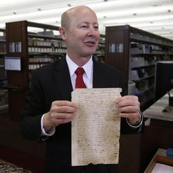 Assistant Church Historian and Recorder Richard E. Turley Jr of The Church of Jesus Christ of Latter-day Saints displays historical documents during a press conference announcing the release of the latest volume in the church's ongoing Joseph Smith Papers project in Salt Lake City, Wednesday, Sept. 4, 2013. This document is the earliest letter completely handwritten by Joseph Smith. It is dated March 8, 1831, and was written to Joseph's brother Hyrum Smith.