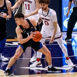 Brigham Young Cougars guard Alex Barcello (13) attempts to pass the ball during a game against Saint Mary's Gaels in Provo on Saturday, Feb.27, 2021.