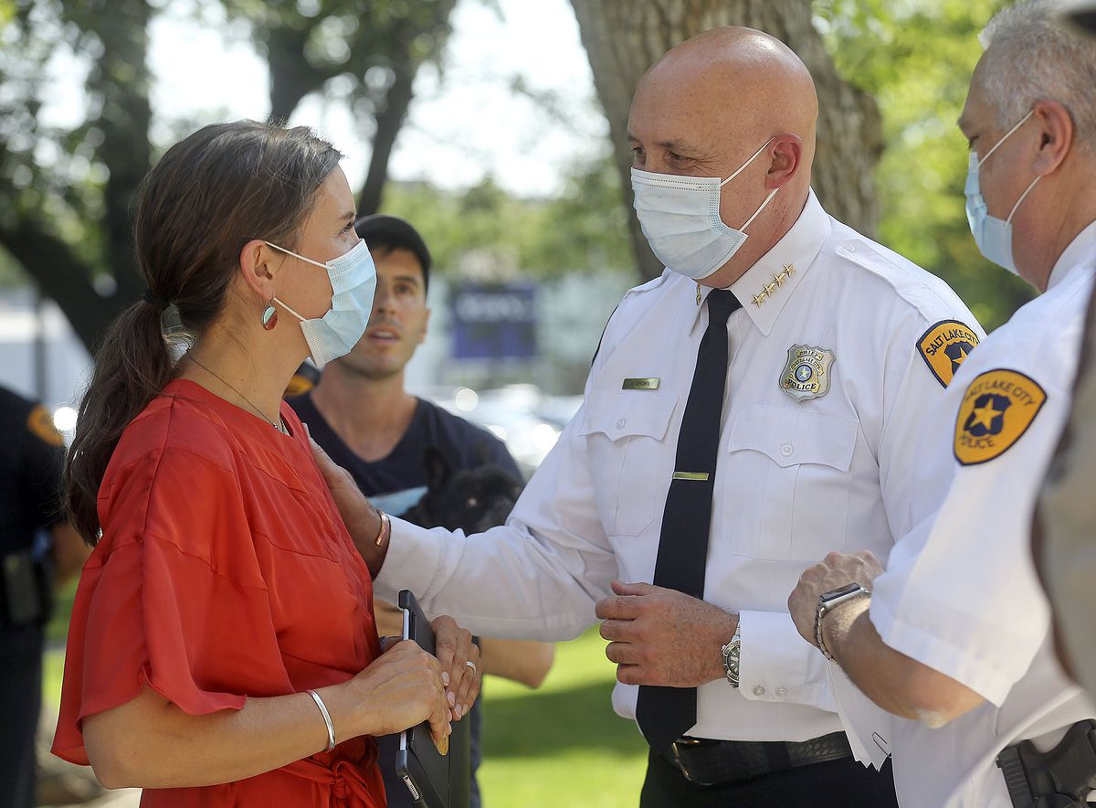 Salt Lake City Mayor Erin Mendenhall talks with Police Chief Mike Brown after speaking at a press conference about changes to the city's police policies — including de-escalation efforts, use of force, body cameras and consent to search — during a press conference outside of the City-County Building in Salt Lake City on Monday, Aug. 3, 2020.