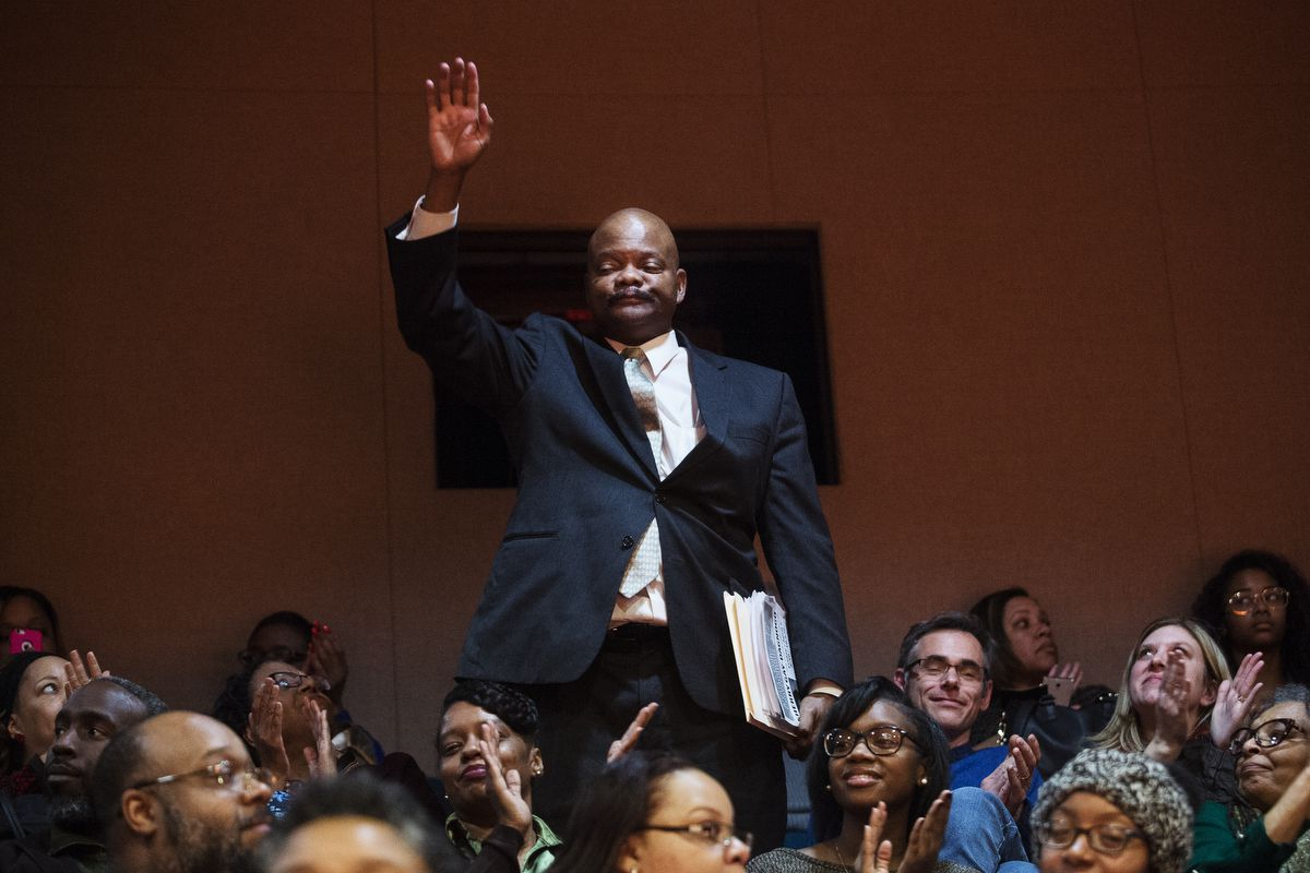 """Detroit Board of Education member LaMar Lemmons waves to the audience during """"School Days,"""" an evening of storytelling focused on the Detroit Public Schools hosted by Chalkbeat Detroit and The Secret Society of Twisted Storytellers in March 2017"""