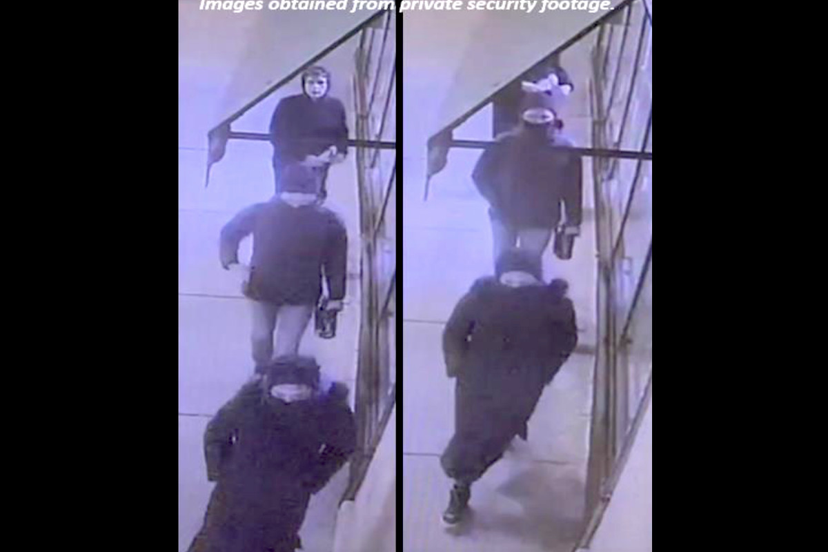 Police released surveillance images of three suspects allegedly spray-painting Mike Bloomberg's campaign office in Edgewater.