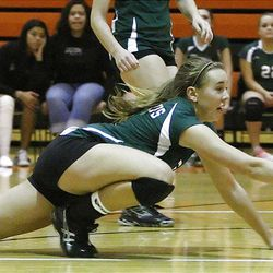 Olympus' Kelsey Lund dives for the ball as the Titans took the win from the Murray Spartans. Olympus came back from two down in the five-set thriller.