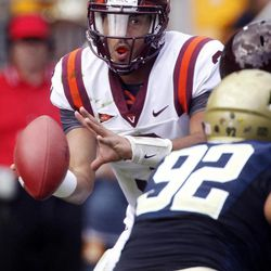 Virginia Tech quarterback Logan Thomas , left, looks to pass as he is pressured by Pittsburgh defensive lineman Bryan Murphy (93) in the second quarter of an NCAA college football game, Saturday, Sept. 15, 2012 in Pittsburgh.