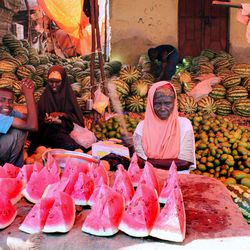 In this photo taken Thursday, March 29, 2012, Somali women sell fruit at the Hamarweyne market in Mogadishu, Somalia. The seaside capital of Mogadishu is full of life for the first time in 20 years after African Union and Somali troops pushed Islamist militants out of the city last year.