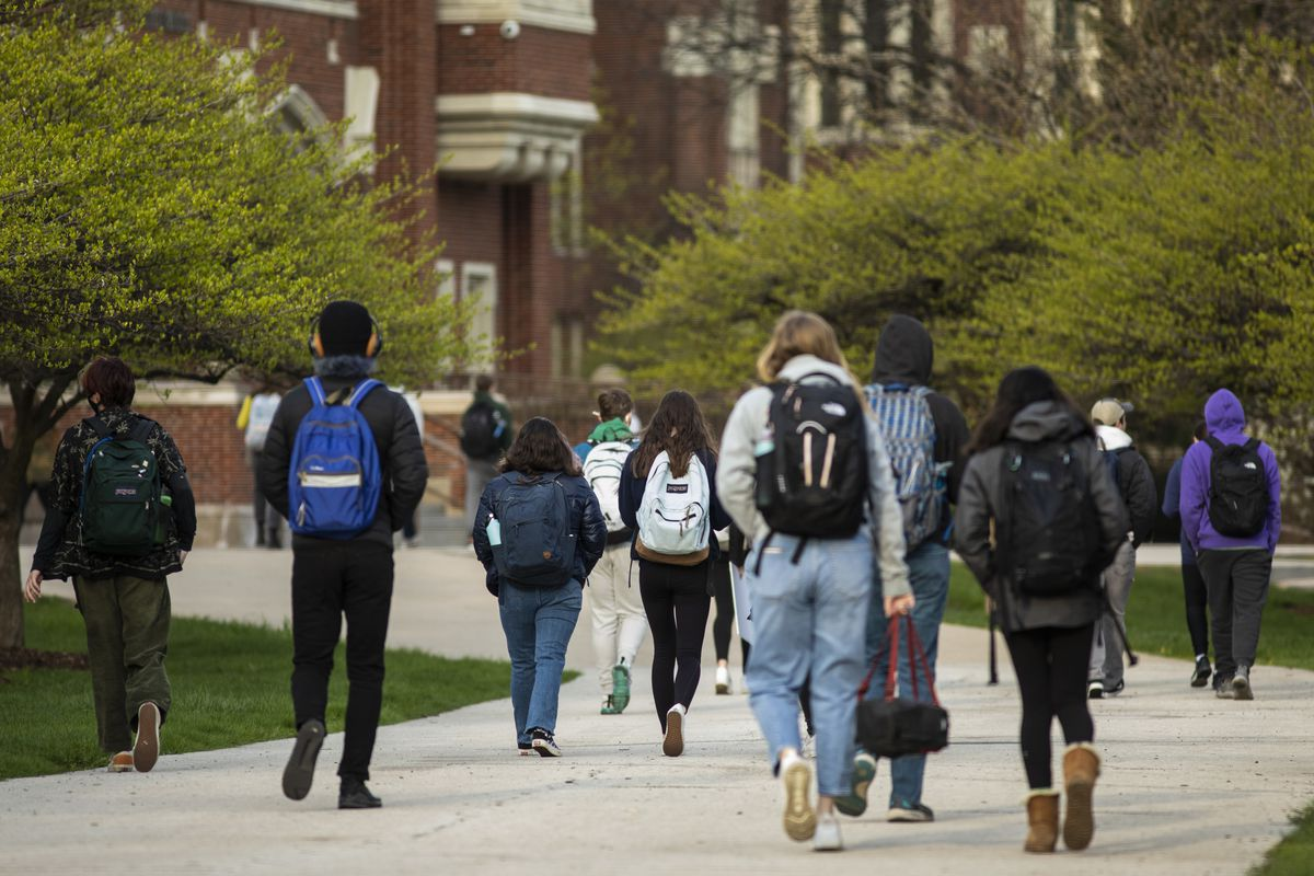 Students head to class at Lane Tech College Prep High School on the North Side, Monday morning, April 19, 2021