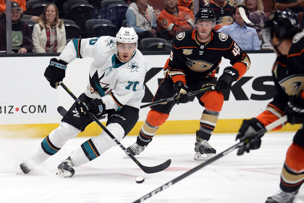 September 20, 2018; Anaheim, CA, USA; San Jose Sharks center Alexander True (70) moves the puck ahead of Anaheim Ducks defenseman Andy Welinski (45) during the second period at Honda Center.