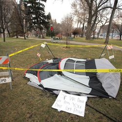 Caution tape, barriers and a tent are all that is left on Sunday, Jan. 5, 2020, after a late Saturday protest on Washington Square in Salt Lake City.
