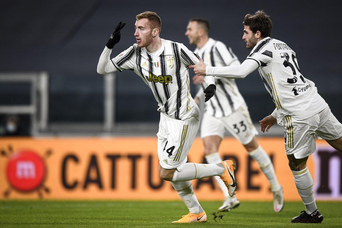 Dejan Kulusevski (L) of Juventus FC celebrates after scoring...
