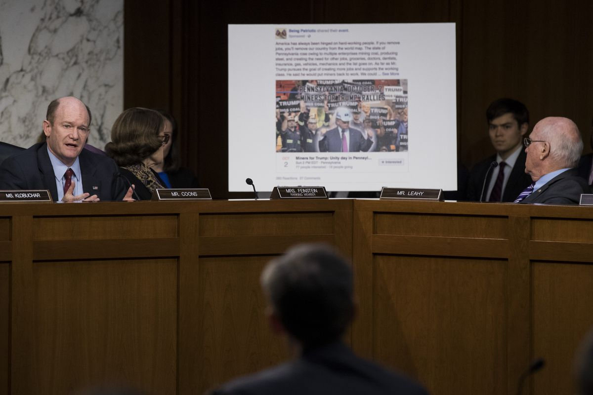 """Sen. Chris Coons (D-DE) displays a """"Miners for Trump"""" event Facebook page set up by Russian operatives during the 2016 election."""